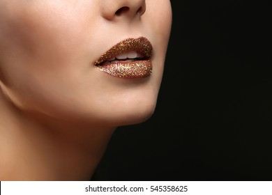 Lips of beautiful young woman model with bright makeup, closeup