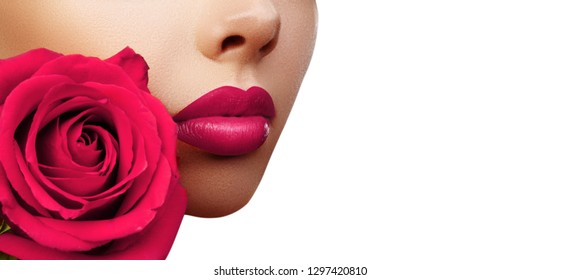 Lips with Bright Lipstick Makeup. Beautiful Macro with Tender Pink Rose Flower. Valentines Day Style with Copy Space for Text