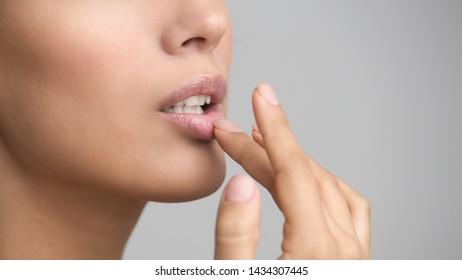 Lips Care. Girl Touching Her Lips on Grey Background, Copy Space
