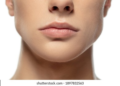 Lips. Close up face of young man isolated on white studio background. Caucasian attractive male model. Concept of fashion and beauty, self-care, body and skin care. Handsome boy with well-kept skin.
