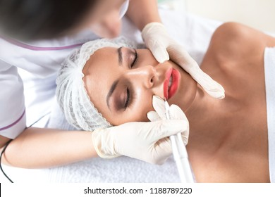 Lips enhancement technique with microblading applied to a beautiful woman