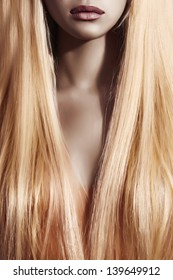 lips and hair of beautiful blond woman. barbi girl