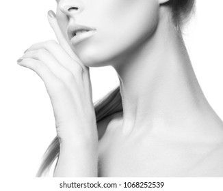 Lips, hand and part of body of beauty model girl. Natural nude make-up, manicure nail polish, perfect clean skin. White background. Skincare facial treatment concept. Black and white