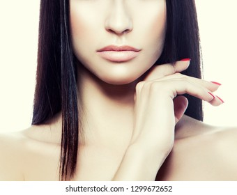 Lips, hand and shoulders of fasion model woman. Natural makeup, clean skin, red nail polish manicure