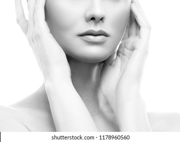 Lips, hands and shoulders of beauty model girl with clean skin and natural nude make-up. Skincare facial treatment concept. Black and white