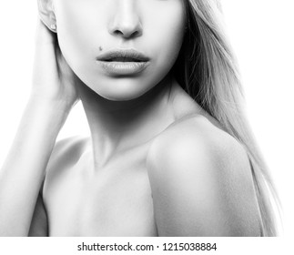 Lips, hands and shoulders of caucasian girl with natural make-up, perfect clean skin. Beauty young woman part of face. Skincare female health concept. White background. Black and white