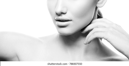 Lips, hands and shoulders of young model girl with nude natural make-up and perfect skin. Skincare treatment woman health concept. Isolated on white background. Black and white