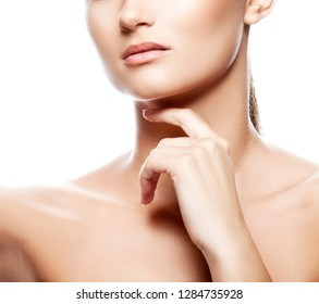 Lips, neck, hand, part of girl beauty face. Clean skin, natural lips, nude make-up. Skincare health concept. White background
