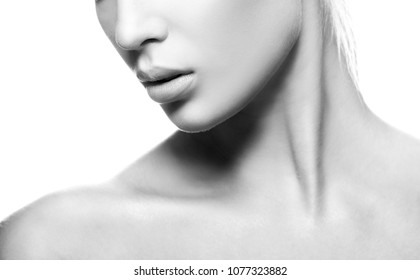 Lips, part of face, neck and shoulder of model girl. Clean skin, natural nude make-up. White background. Skincare facial treatment concept. Black and white