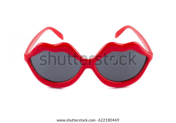 Lips shapes red sunglasses on white background