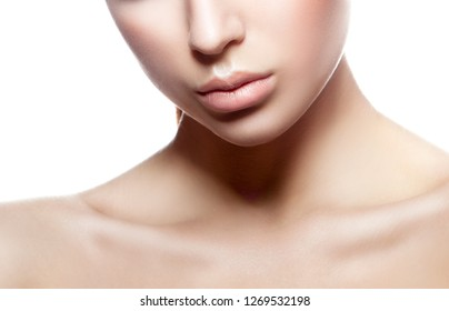 Lips, shoulder of beauty model girl face. Perfect skin, natural nude make-up. White background