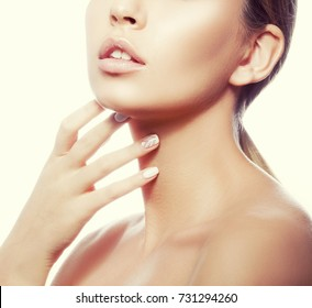 Lips and shoulders of young model girl with nude natural make-up and hand near neck