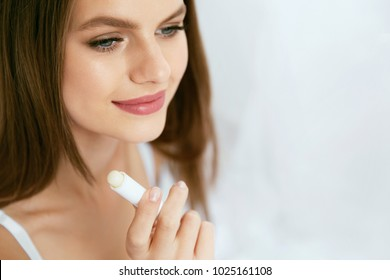 Lips Skin Care. Woman With Hygienic Lip Balm. Portrait Of Beautiful Woman With Beauty Face And Healthy Soft Smooth Skin Holding Hygienic Lipstick. Lips Protection. High Resolution.