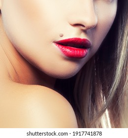 Lips of young girl. Bright make-up. Skin care concept. Red lipstick