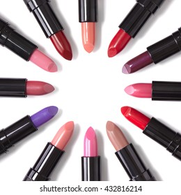 Lipstick colors arranged in a circle and isolated on a white background to form a page border