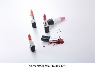 Lipstick. Fashion Colorful Lipsticks Melt isolated on white background. Professional Makeup and Beauty. Beautiful Make-up concept. Set of color melted red lipstick.