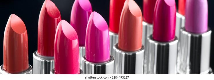 Lipstick. Fashion Colorful Lipsticks over black background. Lipstick tints palette, Professional Makeup and Beauty. Beautiful Make-up concept. Lipgloss. Lipsticks closeup