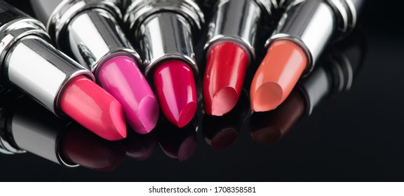 Lipstick. Fashion Colorful Lipsticks over black background. Lipstick tints palette, Professional Makeup and Beauty. Beautiful Make-up concept. Lipgloss. Lipsticks closeup.
