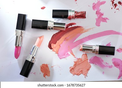 Lipstick. Fashion Colorful Lipsticks smashed isolated on white background. Professional Makeup and Beauty. Beautiful Make-up concept. color smash lipstick.