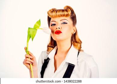 Lipstick. Kiss. Imprint of lipstick on the flower. Woman holding a tulip. Oral caress. Art blowjob. Sex blogger. Penis kisses. Petting. Sex shop. Sex toy.