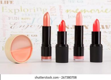 Lipstick and lip balm in a row