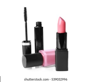 Lipstick, nail polish and mascara on white background
