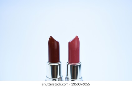 Lipstick for professional make up. Pick color which suits you. Compare makeup products. Lip care concept. Lipsticks on white background. High quality lipstick. Daily make up. Cosmetics artistry.