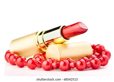 lipstick and red jewelry on white