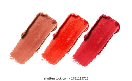 Lipstick smear smudge swatch set isolated on white background. Makeup cream brushstroke texture. Red nude orange lip product close up
