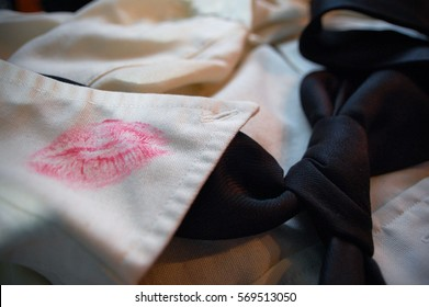 Lipstick stain on the collar of a men's dress shirt.