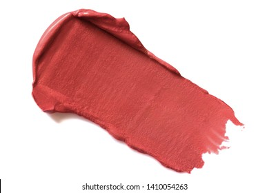 Lipstick stroke, smear, smudge. Coral, red makeup, cosmetic product or paint swatch, sample  isolated on white background.