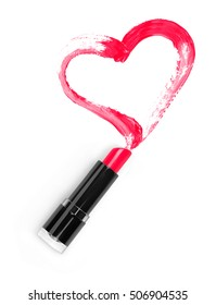 Lipstick and a trace in the form of heart closeup isolated on white background