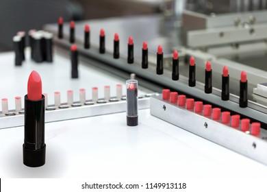 A lipstick vial filling machine in a cosmetics factory.