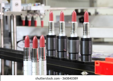 A lipstick vial filling machine in a cosmetics factory.