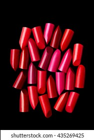 Lipsticks cut composed on black background