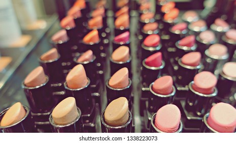 Lipsticks on counter background. High quality lipstick. Daily make up. Cosmetics artistry. Lipstick for professional make up. Pick color which suits you. Compare makeup products. Lip care concept.