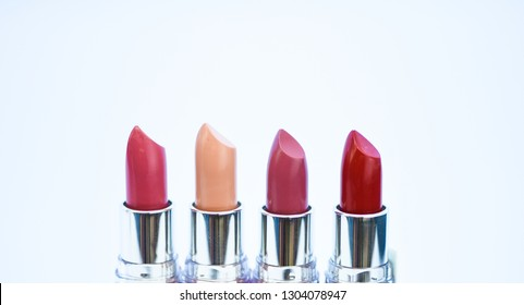 Lipsticks on white background. High quality lipstick. Daily make up. Cosmetics artistry. Lipstick for professional make up. Pick color which suits you. Compare makeup products. Lip care concept.