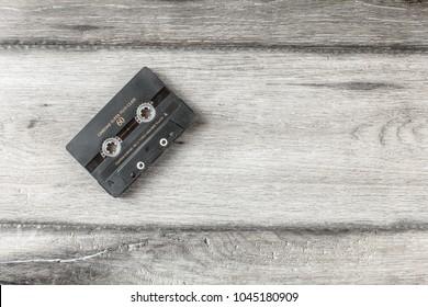 Liptovsky Hradok, Slovakia - March 10, 2018: Table top view on old mixtape cassette on gray wooden desk.