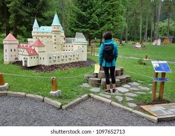 LIPTOVSKY JAN , SLOVAKIA - MAY 18,2018: The site of Slovak Cultural Monuments in the village of Liptovsky Jan, locality of Liptov. Miniature Park,  Historic Buildings and Railroad Model. Editorial.