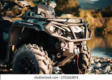 LIPTOVSKY MIKULAS, SLOVAKIA JUN 07, 2020 : Detail close up of army green can-am outlander atv quad motorcycle bike's front light. It look's like very aggressive and strong off - road vehicle.