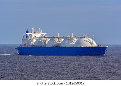 Liquefied natural gas (LNG) tanker underway in high seas.