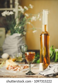 liqueur in a glass on a wooden table (wine) - (celebration) - drink cuisine.  Food background