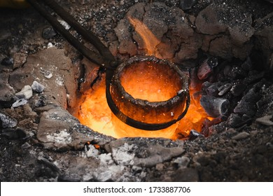 Liquid bronze is being heated to 1200°C. Casting bronze jewelry, Celtic Metalsmith. Experimental Archaeometallurgy. Viking Metal Casting. Bronze Age Forging. The lost-wax method, charcoal-fired hearth