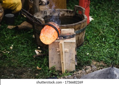 Liquid bronze heated to 1200°C is poured into a mould. Casting bronze jewelry,  Experimental Archaeometallurgy. Viking Metal Casting. Bronze Age Forging. The lost-wax method, charcoal-fired hearth.