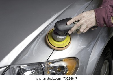 A liquid cleaner is applied to the car finish to remove any grease,road tar and old wax prior to final waxing.