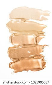 Liquid creamy foundation smudged on white background. Beauty and fashion conception.
