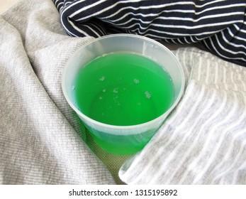 Liquid detergent and laundry