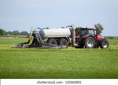 Liquid Manure Spreader; tractor with tank that can directly inject liquid manure into the ground for optimum nutrient placement and odor control; photo was shot in Netherlands, near Amsterdam.