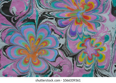 Liquid marbling texture Ebru art. Handmade wave background. Kraft paper surface. Unique art illustration.  Traditional Turkish Ebru technique.