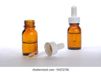 Liquid medicine in bottle on white background